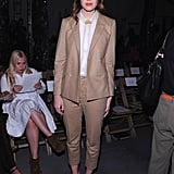 Mandy Moore added bold accessories to her neutral-toned pantsuit, which included pink pointy-toe pumps and a vintage gold brooch, for her appearance at the Boy and Girl by Band of Outsiders show.