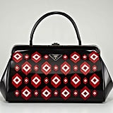 We first fell in love with this Prada diamond spazzolato doctor bag ($3,500) when it came down Prada's Fall 2012 runway. And with such a memorable retro meets quirky print, this is the epitome of a statement accessory.