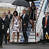 The Obamas were all smiles while touching down for a historic visit to Cuba in March.