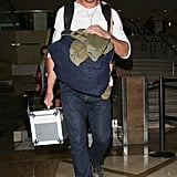 Ryan Gosling had his hands full at LAX.