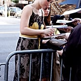Olivia Wilde signed autographs for fans at the Tribeca Film Festival.