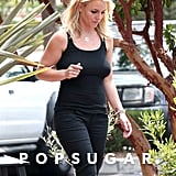 Britney Spears showed off her curves in tight black pants and a black tank top.