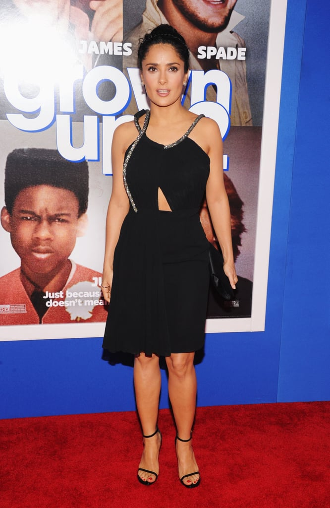 For the NYC premiere of Grown Ups 2, Salma Hayek exuded a subtle sexy appeal in a black Saint Laurent cutout dress and minimalistic ankle-strap sandals.