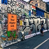 Another must-see historical sight is of course the remnants of the Berlin Wall. For 28 years, this stone wall — one of the most influential symbols of the Cold War — divided more than just a city. It divided the world. While little remains of this barrier today, what is still standing serves as a symbol of freedom and reunification. For those seeking to visit the Berlin Wall, I highly recommend stopping at the East Side Gallery, a memorial which consists of murals and graffiti painted by international artists in 1990 and then again in 2009. This section stretches almost an entire mile and is the longest, best-preserved part of the wall.