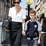 The always posh Victoria Beckham held hands with son Romeo Beckham while shopping in Paris.