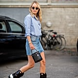 Add a trendy bucket bag to the always iconic denim skirt and cowboy boot pairing.