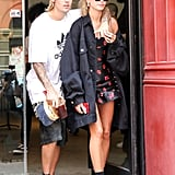 Hailey Baldwin wearing Bec & Bridge minidress with a long denim jacket and Alexander Wang boots.