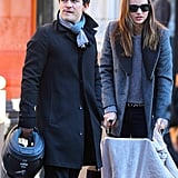 Orlando Bloom and Miranda Kerr take Flynn out for a stroll.