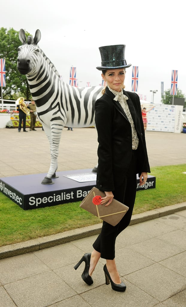 Mischa Barton stood by a zebra installation at the derby.