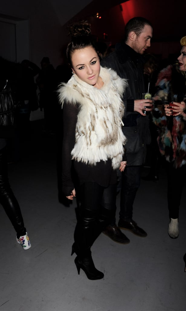 Jaime Winstone teamed a furry gilet with over the knee boots
