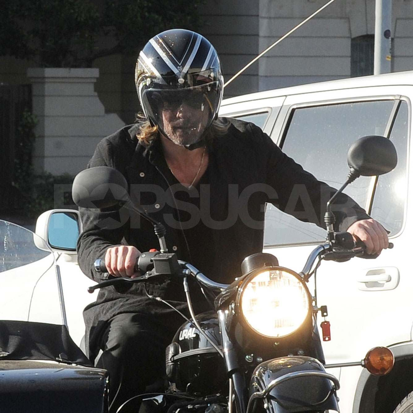 Brad Pitt on a motorcycle.