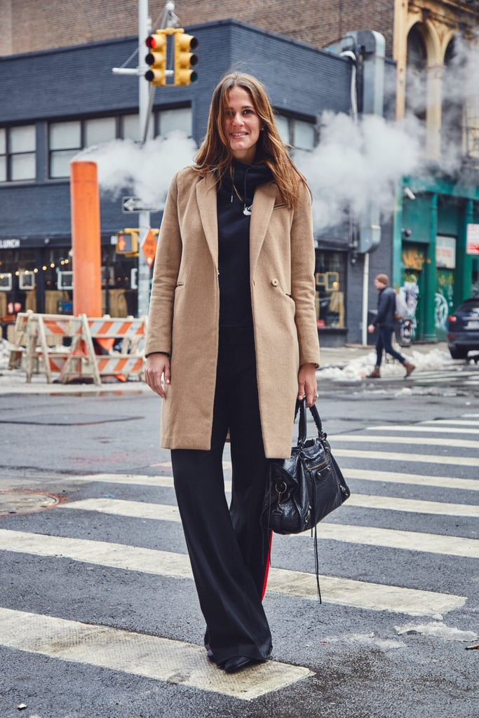 On Fashion Director Hannah Weil McKinley: H&M coat, Nike hoodie, Zara pants, and Balenciaga bag