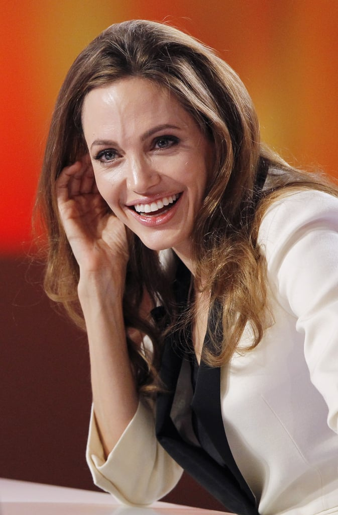 Angelina listened to an interpreter through an ear piece.