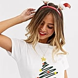 ASOS Design Holidays Headband With Santa Claus Boppers