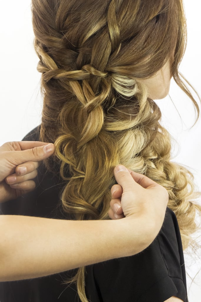 Heavily loosen the braid by tugging at the sides, to the point that it loses much of its plait shape. You want it to look like a series of loops by the time you're done stretching out the style.