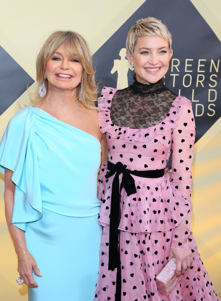 """Earlier this week, Kate Hudson welcomed her third child (and first daughter!), and Goldie Hawn officially became a grandmother to six beautiful grandchildren. While the loving Hollywood family has been making us swoon over their bond for decades, it's Goldie's recent parenting advice that is hitting close to home. During an event celebrating a collaboration with her daughter's Fabletics brand, Goldie sat down with People to discuss all things parenting and shared some of her greatest familial wisdom. """"We do the best we can as mothers,"""" Goldie said. """"Certainly, as a mother, I've made mistakes. We all do, we all will. But the most important thing is to stay authentic and true to yourself and hope that you show by example, not by what you say but by what you do."""" Goldie and Kate's close relationship is one that so many mothers and daughters have idolized, and we're pretty much convinced that compassion, optimism, and warmth just runs in their blood, but Goldie explained she leads by example. """"We hope our children will amplify the best part of us,"""" she said. """"I'm proud of my daughter. She has become a spokesperson herself for children's wellness, for happiness, all the things that she grew up with."""" She added, """"I'm not conscious of going, 'I need to be a role model.' Heck no. I am my own role model. I live by my own ethics and my own standards and my own sense of love. That's who I am. I think every one of my children, I can say wholeheartedly, has this wonderful attribute."""" Her final advice to Kate and to all parents is to live in the moment and savor it all. """"Each stage brings you a different kind of happiness, so focus on that,"""" Goldie shared. """"Sometimes they'll drive you crazy, but just focus on the joy of being able to do this at all."""" Now that is right! Read on to see recent photos of Kate and Goldie's adorable bond.      Related:                                                                                                           Kurt Russell and Goldie Hawn'"""