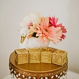 The gilded baby blocks added a sophisticated flare to typical baby-shower decor.