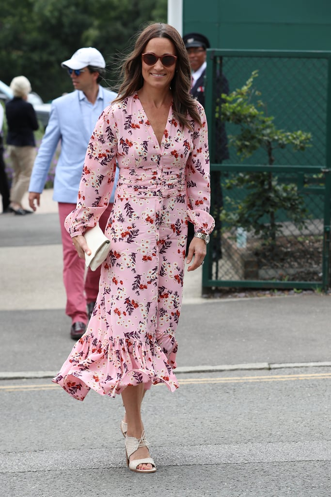 Florals for Spring? Groundbreaking. Florals for Summer? Mindblowing. Pippa Middleton has shown over and over again that Wimbledon is the place to break out gardenesque prints, and her last look for the event follows the same theme. A day after she watched the Women's Final with her sister, Kate Middleton, and Kate's sister-in-law, Meghan Markle, Pippa reached for yet another floral dress worthy of warm weather and time outside. She enjoyed the Men's Final with her mother, Carole, and her brother, James, and we enjoyed seeing the outfit she chose.   For her last Wimbledon 2019 visit, Pippa chose a byTiMo gathered midi dress with long sleeves and a dainty ruffled hemline. She paired the pretty pink number with a white clutch and matching heels, plus a pair of dark sunglasses and her gorgeous engagement ring. Game, set, match — Pippa wins every stylish round. Keep reading to see her outfit from all angles below.