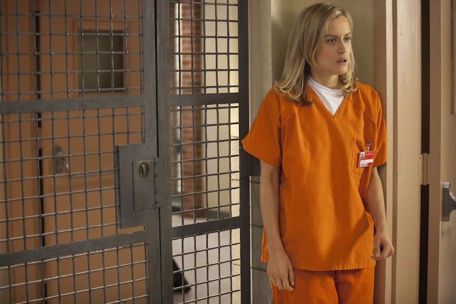 No movie-star treatment here: Taylor's onscreen look is an orange jumpsuit.  Source: Netflix