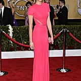 Among a sea of black, Nina Dobrev's pink crepe Elie Saab gown was a welcome pop of color. The brunette stunner upped the glam factor with diamond drop earrings, a matching bracelet, and mirrored minaudière.