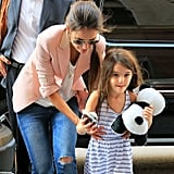 Suri Cruise juggled a cupcake and stuffed panda with mom Katie Holmes.