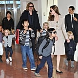 Angelina Jolie walked through the airport with Brad Pitt and their brood, sons Maddox, Pax, and Knox, and daughters Shiloh, Zahara, and Vivienne Jolie-Pitt during a trip to Tokyo in November 2011.