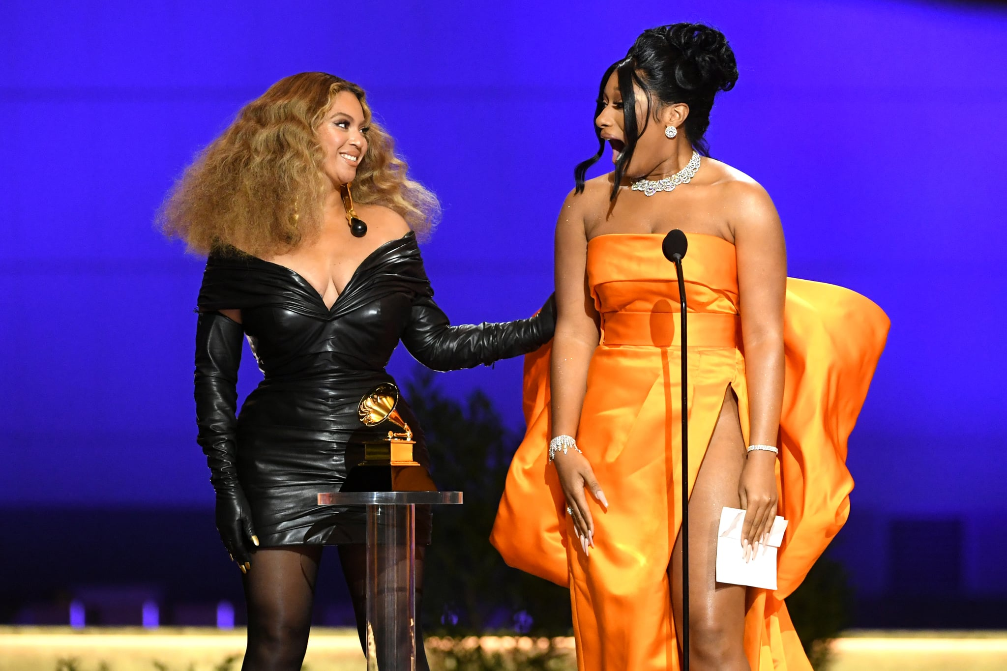 LOS ANGELES, CALIFORNIA - MARCH 14: (L-R) Beyoncé and Megan Thee Stallion accept the Best Rap Performance award for 'Savage' onstage during the 63rd Annual GRAMMY Awards at Los Angeles Convention Centre on March 14, 2021 in Los Angeles, California. (Photo by Kevin Winter/Getty Images for The Recording Academy)