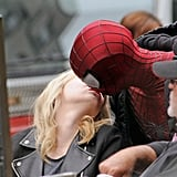 Sporting his Spider-Man costume, Andrew gave Emma a kiss during a break from filming in NYC in May 2013.