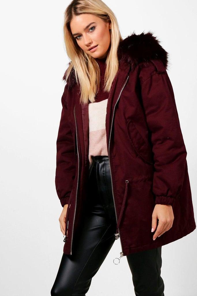 3d525fe307a5 In rich burgundy, the Boohoo Niamh Faux Fur Hood Parka ($96) hits a ...