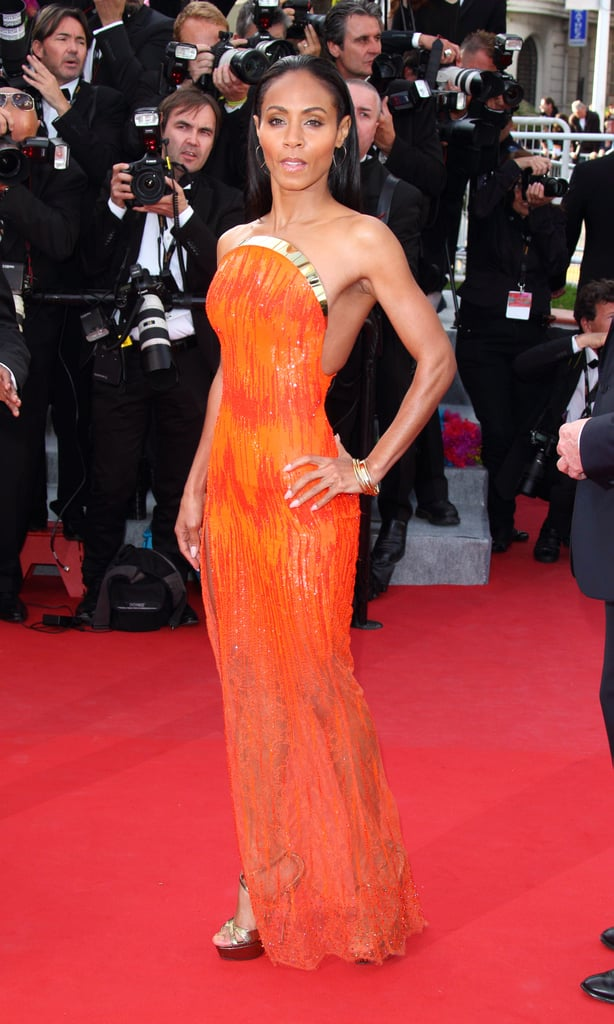 Just like Elizabeth Banks, Jada Pinkett Smith donned a bright orange Atelier Versace gown, which looked insanely cool on her, at the Madagascar 3 premiere in Cannes.