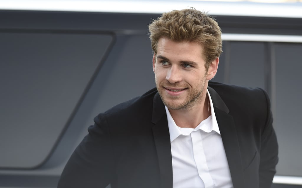 "Liam Hemsworth has really perfected the art of the sexy smolder. The star, who was recognized as ""The New A-Lister,"" has become one of Hollywood's hottest heartthrobs — which, based on his brother Chris Hemsworth's Sexiest Man Alive title, seems to run in the family. While Liam definitely brought some seriously sexy looks to the big screen with his role in The Hunger Games, he's also had plenty of swoon-worthy moments off screen, too, both on the red carpet and in magazines. Take a look at knee-weakening pictures of Liam, then check out his adorable picture with his dog plus his cutest moments with his famous brothers."