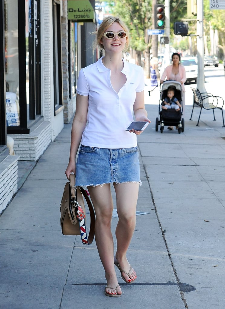 Elle Fanning Wears Denim Skirt and Polo in LA September ...