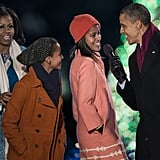 The president encouraged daughter Malia to sing some carols.