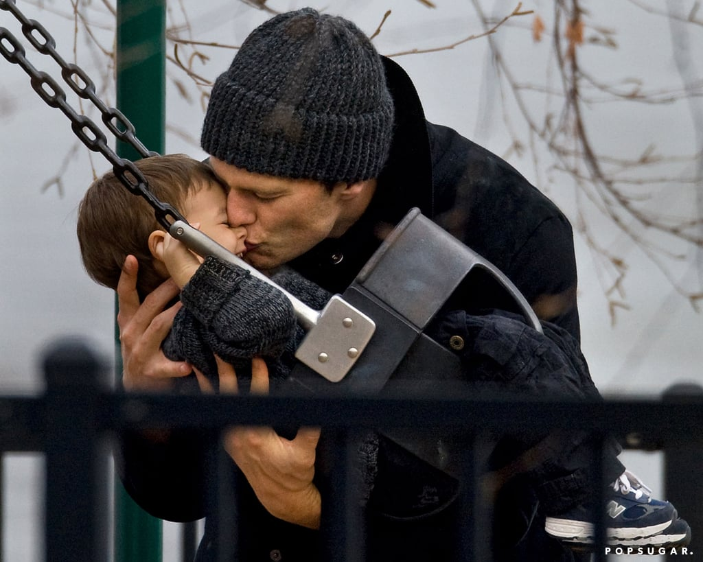 Tom Brady kissed his son Benjamin while playing on a swing set in Boston back in November 2011.