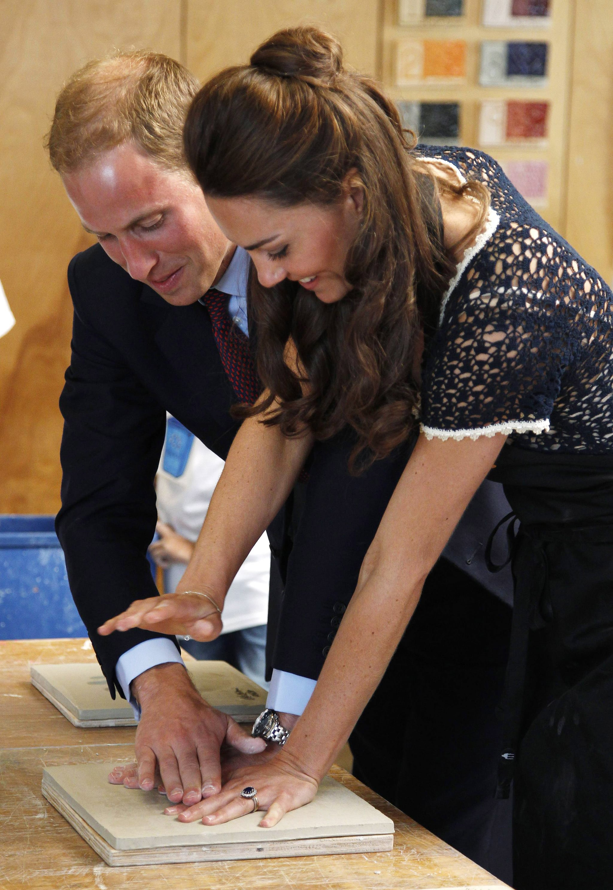 Kate Middleton and Prince William making hand prints in LA.