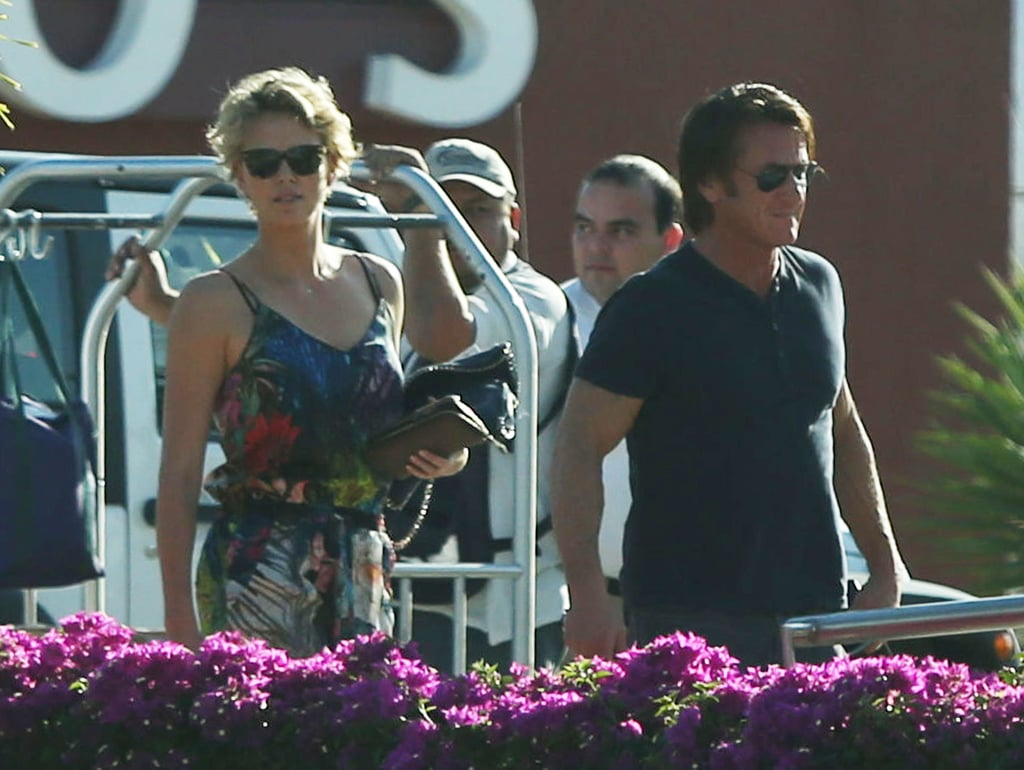 Charlize Theron and Sean Penn are no strangers to romantic vacations. Back in January, they rang in the New Year on the beach in Hawaii together, and on Monday, they were spotted in Cabo San Lucas. Charlie wore a tropical-colored jumpsuit, while Sean went for a black tee and jeans, as they strolled together in Mexico, all smiles as they soaked up the sun.  The Valentine's getaway is just their latest adorable outing after goofing around with Charlize's son, Jackson, at the grocery store and enjoying a walk on the beach in Malibu, CA, since coming out publicly as a couple late last month.