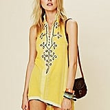 A sleeveless yellow tunic that can easily go from the beach to the streets.  FP New Romantics Embroidered Tassel Tunic ($148)