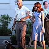 Ryan Gosling and Emma Stone walked arm-in-arm on the set of The Gangster Squad.