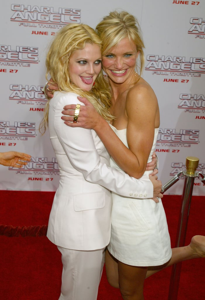 BFFs Drew Barrymore and Cameron Diaz got playful on the red carpet during the LA premiere of Charlie's Angels 2: Full Throttle in June 2003.