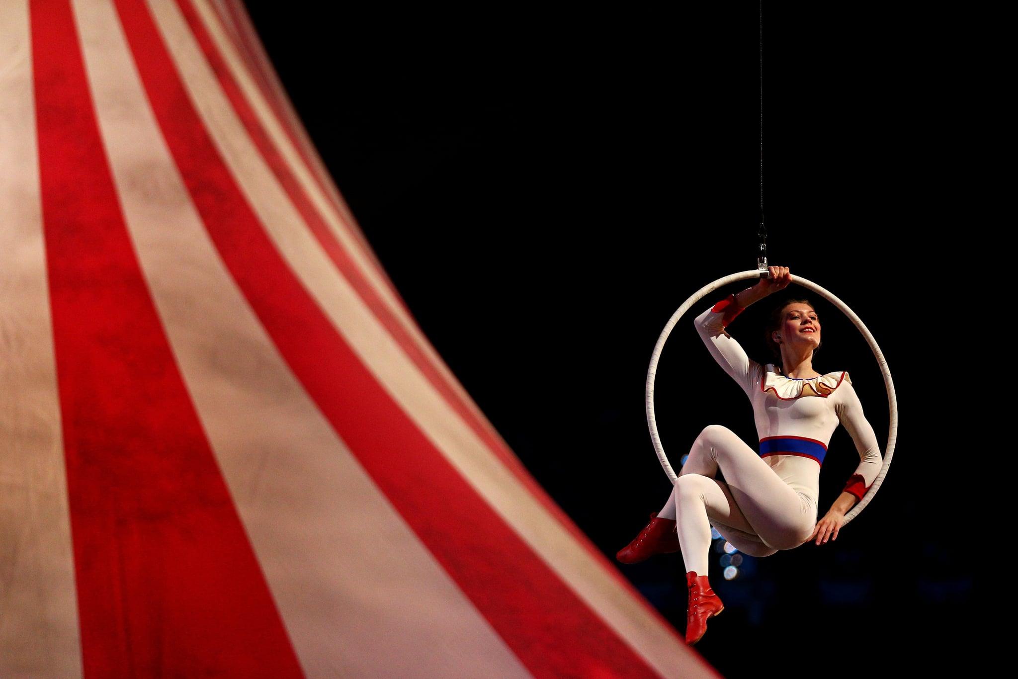 Circus performers danced in hoops.