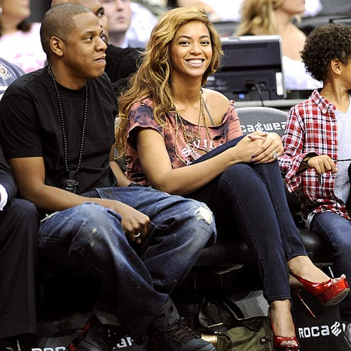 Beyonce and Jay-Z  watch the New Jersey Nets beat the Detroit Pistons, 101-98, at Newark's Prudential Center on Wednesday.