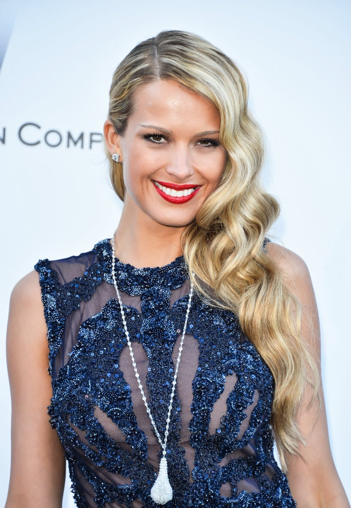 Petra Nemcova's studded hair barrette was only one element of shimmer in her amfAR look. Her vintage waves and bright red lip were classically gorgeous.