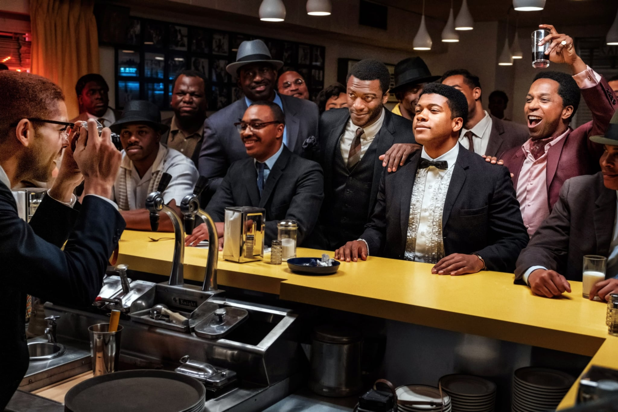 ONE NIGHT IN MIAMI, beginning at centre from left: Aldis Hodge as Jim Brown, Eli Goree as Cassius Clay, Leslie Odom Jr. as Sam Cooke, 2020. ph: Patti Perret /  Amazon / Courtesy Everett Collection
