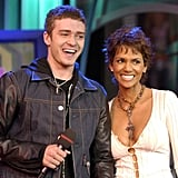 Justin Timberlake knew he was a lucky man standing next to Halle Berry during his November 2002 TRL performance.