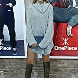 She wore an oversize tunic sweater and knee-high boots for an event in 2014.