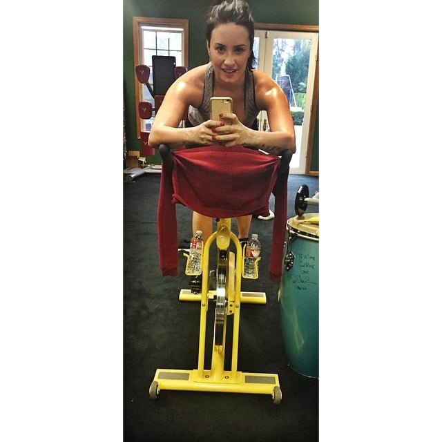 "Demi Lovato is back to her usual SoulCycle routine. She shared this gem of wisdom: ""Don't train to be skinny, train to be a #badass."""