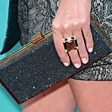 Nicky Hilton echoed the moody metallics in her dress with a gun-metal-hued, sparkling clutch and dramatic cocktail ring.