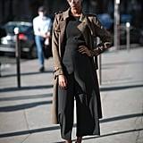 Add a neutral coat to break up a sleek all-black look.