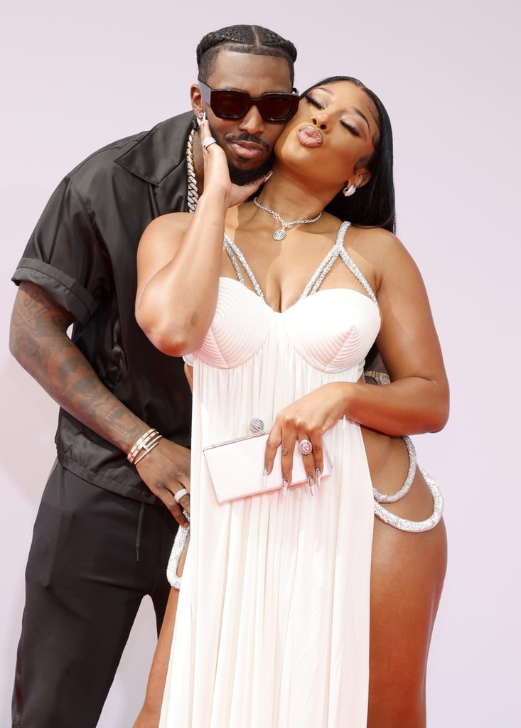 """Megan Thee Stallion and Pardi Fontaine were the queen and king of the BET Awards on Sunday night. Ahead of the award show, where Megan is nominated for seven awards, the """"Body"""" rapper walked the carpet with boyfriend Pardison """"Pardi"""" Fontaine. After working the camera from all angles in her stunning gown, Megan cuddled up with Pardi for a few adorable snaps. As Pardi rested his hands on Megan's hips, she could be seen pulling him in for a kiss. The cute appearance comes almost a month after the couple made their official red carpet debut at the iHeartRadio Music Awards, where they were ultimate couple goals in matching gold outfits. See their latest appearance ahead.       Related:                                                                                                           Please Place Your Attention on These Fabulous BET Awards Red Carpet Looks"""