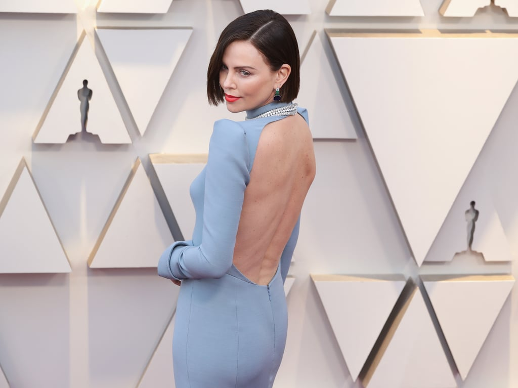 """Charlize Theron underwent a significant makeover right before a casual little event known as the 2019 Oscars. The actress, who has worn her hair in a blond bob for some time now, dyed her hair dark brown and cut it slightly shorter before the award show on Feb. 24. In fact, her hairstylist Adir Abergel said he had dyed Charlize's hair earlier in the week and cut it that very morning. He added, """"Hair is your greatest accessory and the best way to transform a look quickly."""" Bold brown hair aside, Charlize also kept her makeup fun and fresh with an orange-red lipstick. Check out Charlize's exciting red carpet reveal ahead.      Related:                                                                                                           Every Glamorous Gown From the 2019 Oscars"""
